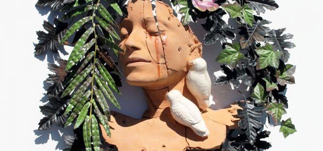 Luca Freschi - Donna Selva - terracotta policroma invetriata e corona floreale in lamiera -  cm 53x65x13 - valore assicurativo euro 1.800